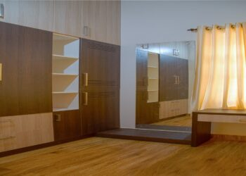 Luxury wardrobe in Walnut bronze colour with drawers and shelving units.