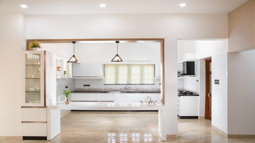 Furnished kitchen with black and white tiles walls, decoration and designs.